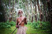 Rubber plantation worker.