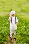 Cute Farmer Boy In Potato Rows