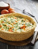 foto of nettle  - Quiche pie with fish and nettles on the table