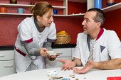 Two Nurses Talking About Money