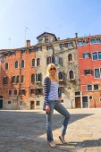 Attractive Girl On A Background Of Old Houses In Venice, Italy