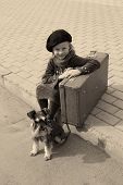 Vintage photo of a little girl and his dog