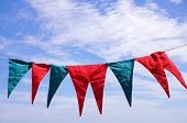 Blue and red pennants hanged over blue sky