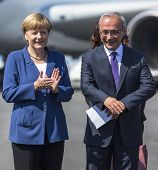 BERLIN, GERMANY - MAY 20, 2014: German Chancellor Angela Merkel (R) and Turkish Minister of transpor