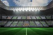 Digitally generated large football stadium under spotlights