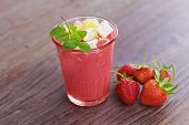 glass of delicious strawberry shake - food and drink