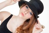 beautiful fashion teen in makeup and hat