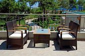 Rattan Armchairs On Terrace Lounge In A Luxury Resort .