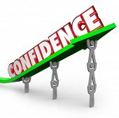 Confidence word lifted on arrow by team working together confident success is achievable