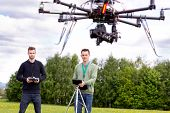 pic of drone  - Professional team of a photographer and pilot operating a UAV Photography Drone - JPG
