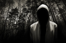pic of hoods  - Portrait of dangerous man hiding under the hood in the forest - JPG