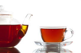 pic of black tea  - Glass cup of tea and teapot on a white background - JPG