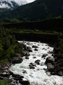 Roaring River In Green Himalayan Landscape