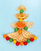 Christmas tree lined with candy and waffles on table