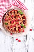 Tasty cake with berries on table close-up