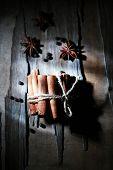 Cinnamon on dark wooden background, close-up