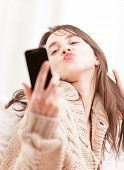 Young Woman Making Herself A Selfie