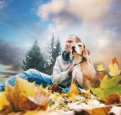 Man With Beagle On Autumn View Landscape