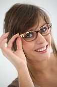 Young woman with modern eyeglasses, isolated
