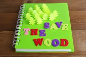 Concept of conservation forests cut paper on notebook