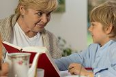 picture of babysitter  - Portrait of senior babysitter caring about schoolboy - JPG