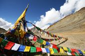stock photo of manali-leh road  - Plenty of colorful Buddhist prayer flags on the road between Leh and Manali