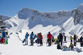 SOCHI, RUSSIA - MARCH 22, 2014: Tourists in mountain ski resort Rosa Khutor,