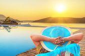 Woman in hat enjoying sun holidays in Greece