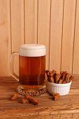 Mug With Light Beer And Salty Crackers