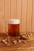 Mug With Light Beer And Pistachios