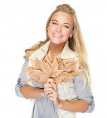 Portrait of cute happy woman with leaves bouquet in hands isolated on white background, autumn season concept
