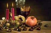 Rustic traditional christmas still-life with wine and seasonal fruits
