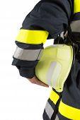 Firefighter holding helmet isolated on white