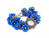 Watch with blue flowers.