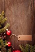 Christmas Tree and decorations on wooden background paper for labels