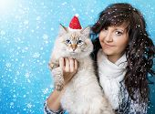 Charming Young Woman With Cat In Santa Cap