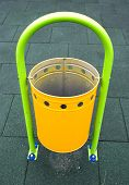 Yellow Recycle Bin On A Playground