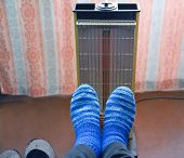 Warming Of Feet A Heater With A Quartz Lamp.
