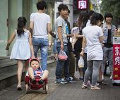 Chinese Boy In A Cart