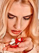 Illness woman having flu takes pills.
