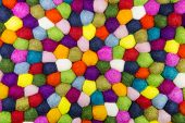 Colorful felt background for creative items.