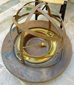 Old brass brazier with handles on wooden platform