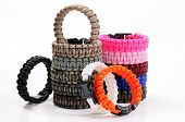 Parachute cord bracelets of different colors on a white background