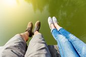 Woman and man legs in water pond
