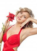 closeup portrait of attractive  caucasian  woman blond isolated on white studio shot lips face hair head and shoulders looking at camera blue eyes tooth red rose flower aroma