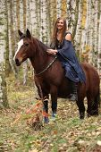Amazing Girl Riding A Horse Without Any Equipment In Autumn Forest