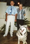 RISHON LE ZION, ISRAEL, CIRCA NINETIES: vintage photo of elderly couple with Alaskan Malamute dog