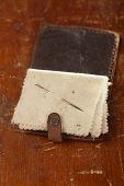 Vintage leather  Needle Book on old table, shallow dof