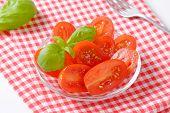 tomato salad with basil on checkered dishtowel