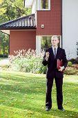 Elegant House Agent Wearing Suit